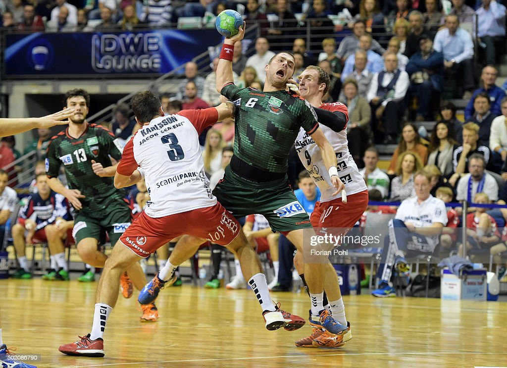 Tobias Karlsson of SG Flensburg-Handewitt, <a gi-track='captionPersonalityLinkClicked' href=/galleries/search?phrase=Drago+Vukovic&family=editorial&specificpeople=2327740 ng-click='$event.stopPropagation()'>Drago Vukovic</a> of Fuechse Berlin and <a gi-track='captionPersonalityLinkClicked' href=/galleries/search?phrase=Holger+Glandorf&family=editorial&specificpeople=687256 ng-click='$event.stopPropagation()'>Holger Glandorf</a> of SG Flensburg-Handewitt during the game between Fuechse Berlin and the SG Flensburg-Handewitt on december 20, 2015 in Berlin, Germany.