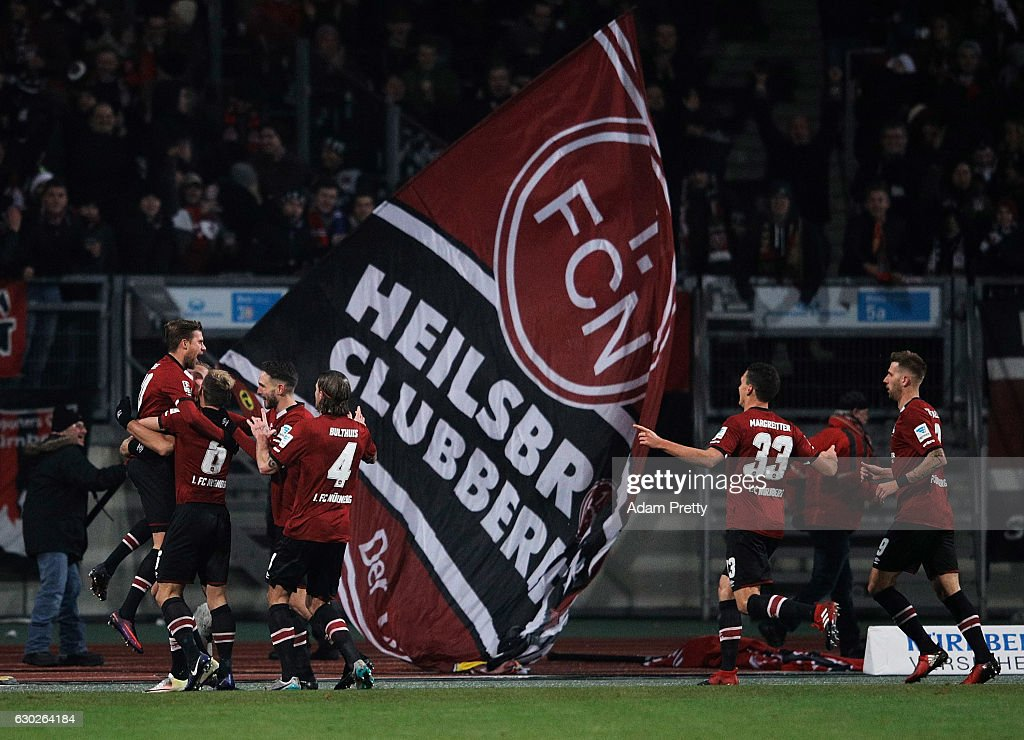 Tobias Kempe of 1. FC Nuernberg is congratulated after scoring a goal during the Second Bundesliga match between 1. FC Nuernberg and 1. FC Kaiserslautern at Arena Nuernberg on December 19, 2016 in Nuremberg, Germany.