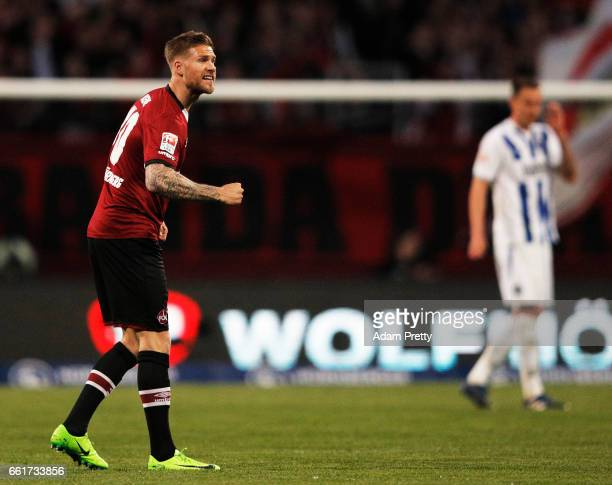 Tobias Kempe of 1FC Nuernberg celebrates scoring a penalty goal during the Second Bundesliga match between 1 FC Nuernberg and Karlsruher SC at Arena...