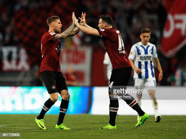 Tobias Kempe of 1FC Nuernberg celebrates scoring a penalty goal with Kevin Moehwald of 1FC Nuernbergduring the Second Bundesliga match between 1 FC...