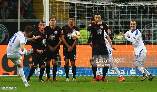 Tobias Kempe of Darmstadt attemps to score with a freekick during the Bundesliga match between Eintracht Frankfurt and SV Darmstadt 98 at...
