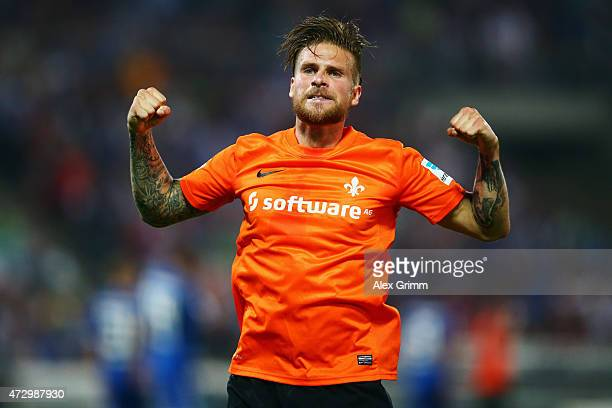 Tobias Kempe of Darmstadt celebrates his team's first goal during the Second Bundesliga match between Karlsruher SC and SV Darmstadt 98 at Wildpark...