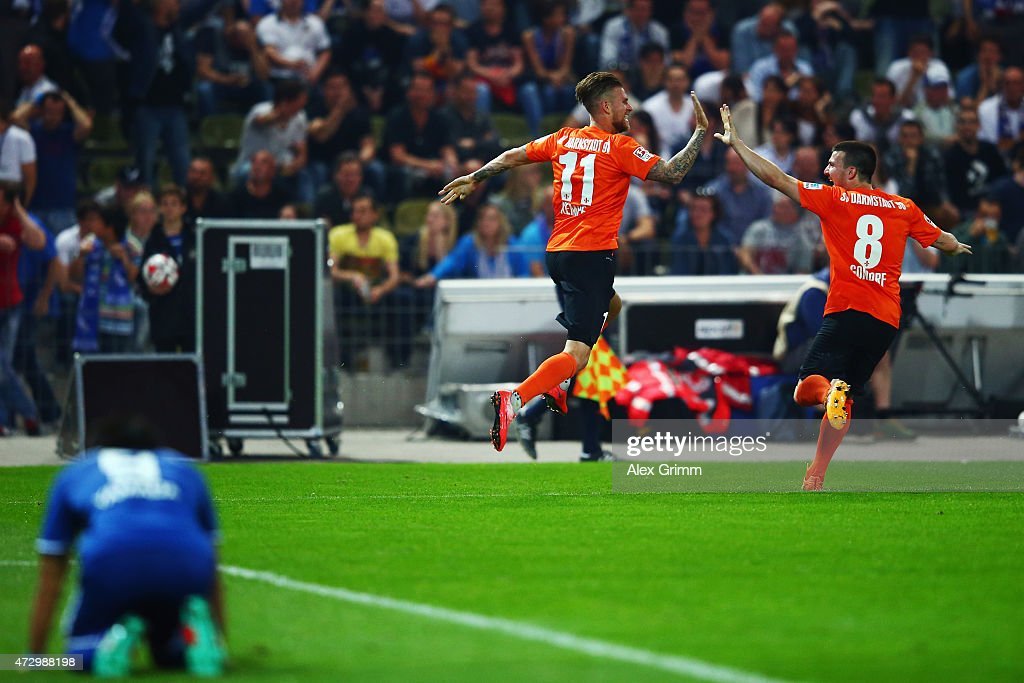 Tobias Kempe of Darmstadt celebrates his team's first goal with team mate Jerome Gondorf during the Second Bundesliga match between Karlsruher SC and...