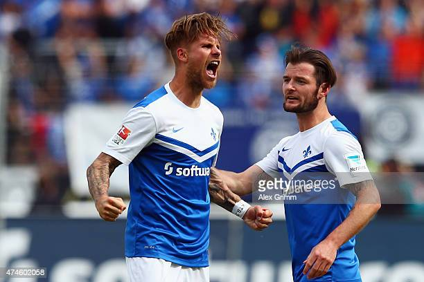 Tobias Kempe of Darmstadt celebrates his team's first goal with team mate Marcel Heller during the Second Bundesliga match between SV Darmstadt 98...