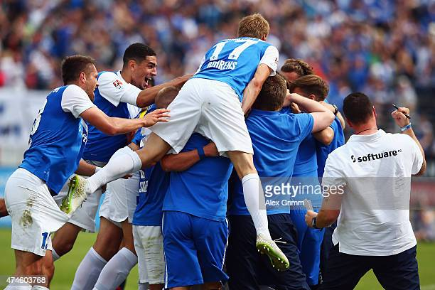 Tobias Kempe of Darmstadt celebrates his team's first goal with team mates during the Second Bundesliga match between SV Darmstadt 98 and FC St Pauli...