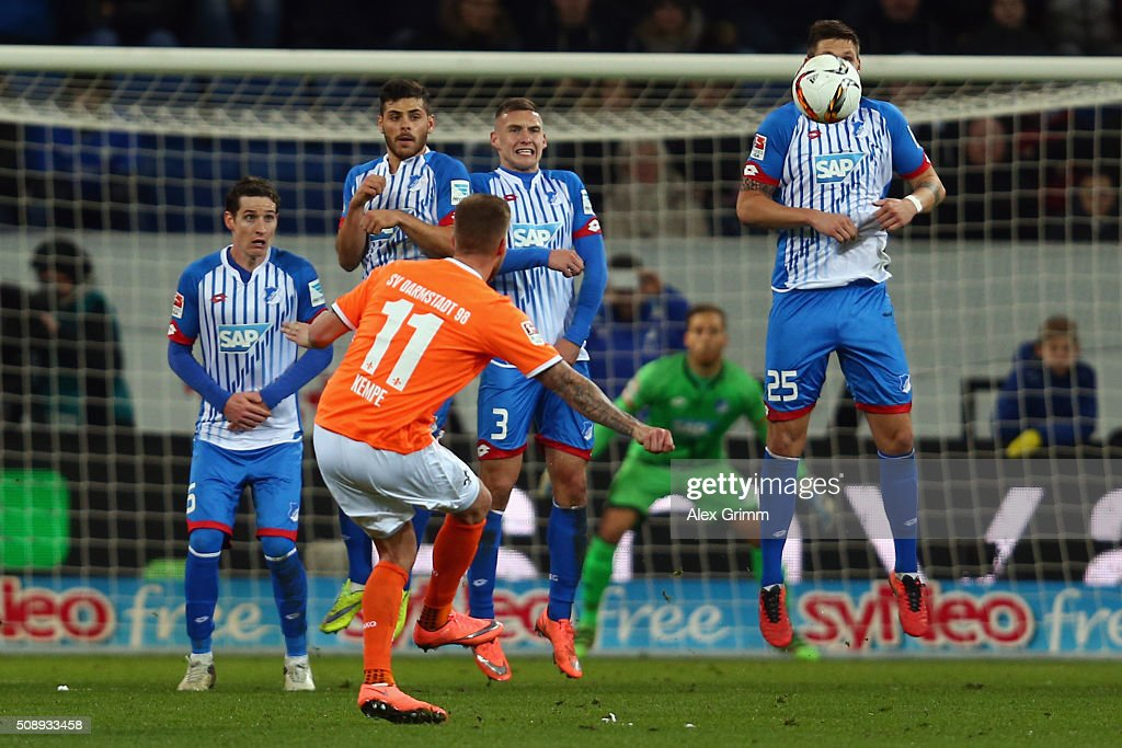 Tobias Kempe of Darmstadt shoots a free-kick during the Bundesliga match between 1899 Hoffenheim and SV Darmstadt 98 at Wirsol Rhein-Neckar-Arena on February 7, 2016 in Sinsheim, Germany.