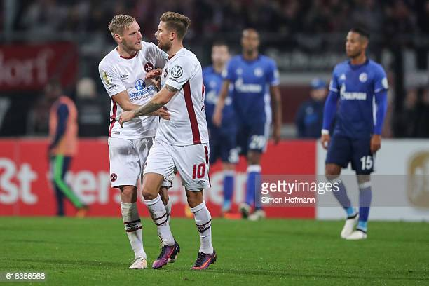 Tobias Kempe of Nuernberg celebrates his team's first goal with team mate Hanno Behrens during the DFB Cup match between 1 FC Nuernberg and FC...