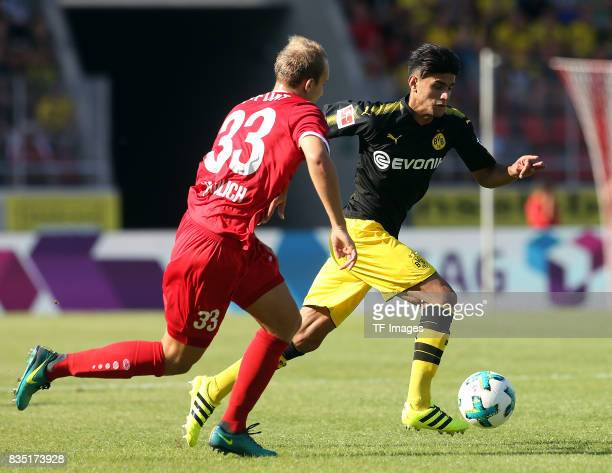 Tobias Kraulich of Erfurt and Mahmoud Dahoud of Dortmund battle for the ball during the preseason friendly match between RotWeiss Erfurt and Borussia...