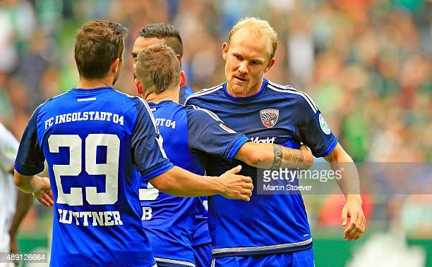 Tobias Levels of Ingolstadt and his team mates celebrate during the Bundesliga match between Werder Bremen and FC Ingolstadt at Weserstadion on...