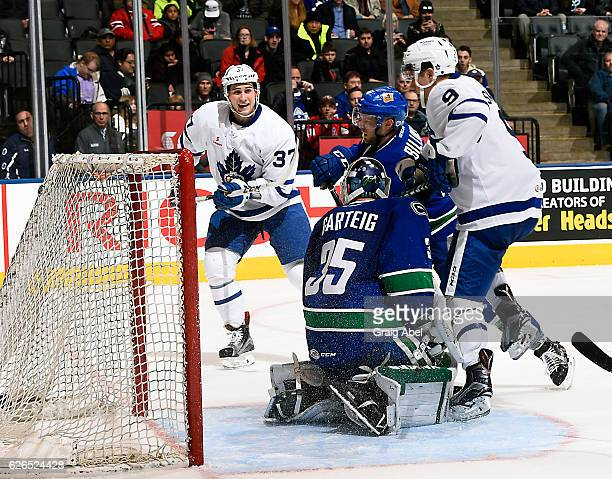 Tobias Lindberg celebrates when Colin Smith of the Toronto Marlies puts one by Chad Billins and Michael Garteig of the Utica Comets during game...