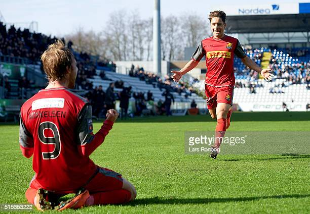 Tobias Mikkelsen and Emre Mor of FC Nordsjalland celebrate after scoring their first goal during the Danish Alka Superliga match between OB Odense...