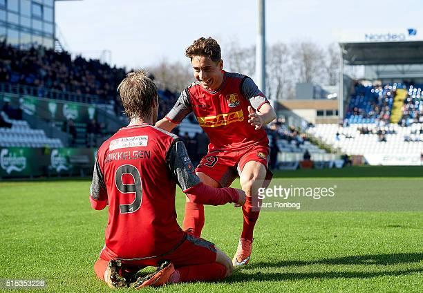 Tobias Mikkelsen and Emre Mor of FC Nordsjalland celebrate after scoring their first goal during the Danish Alka Superliga match between OB Odense...
