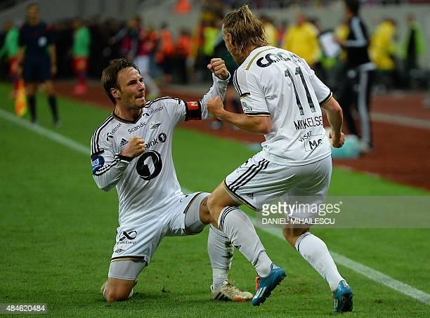 Tobias Mikkelsen and Mike Jensen of Rosenborg BK celebrates after scoring during the UEFA Europa League playoff football match between Steaua...