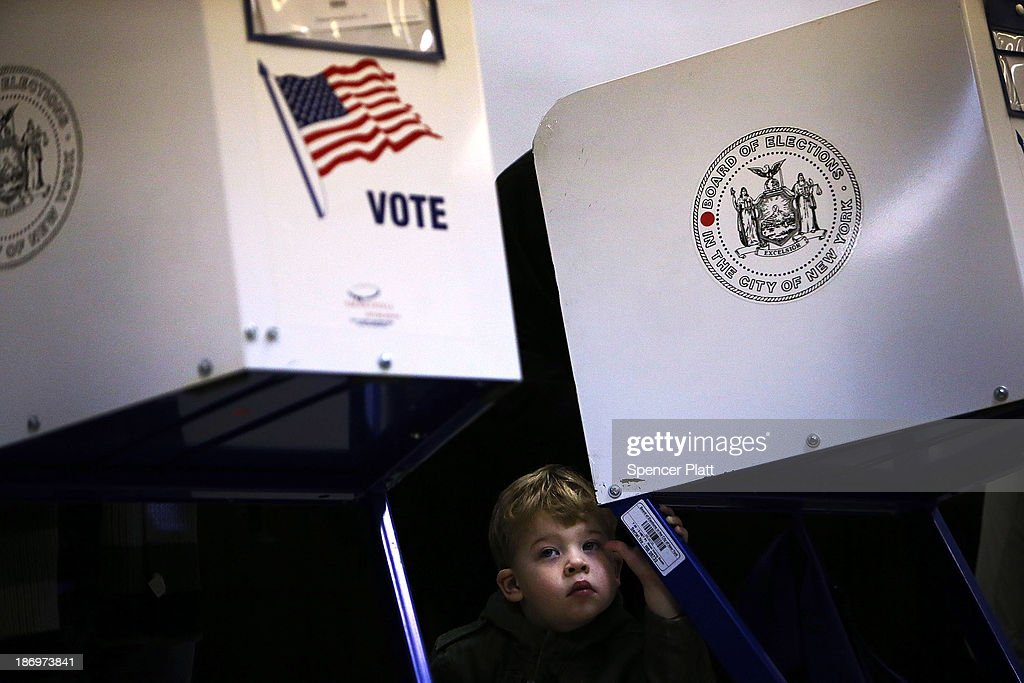 Tobias Nichols, 2, waits for his father, Dan Nichols, to vote on Election Day on November 5, 2013 in the Brooklyn borough of New York City. New York Democratic mayoral candidate Bill de Blasio is running against Republican mayoral candidate Joe Lhota in a highly anticipated mayoral campaign.