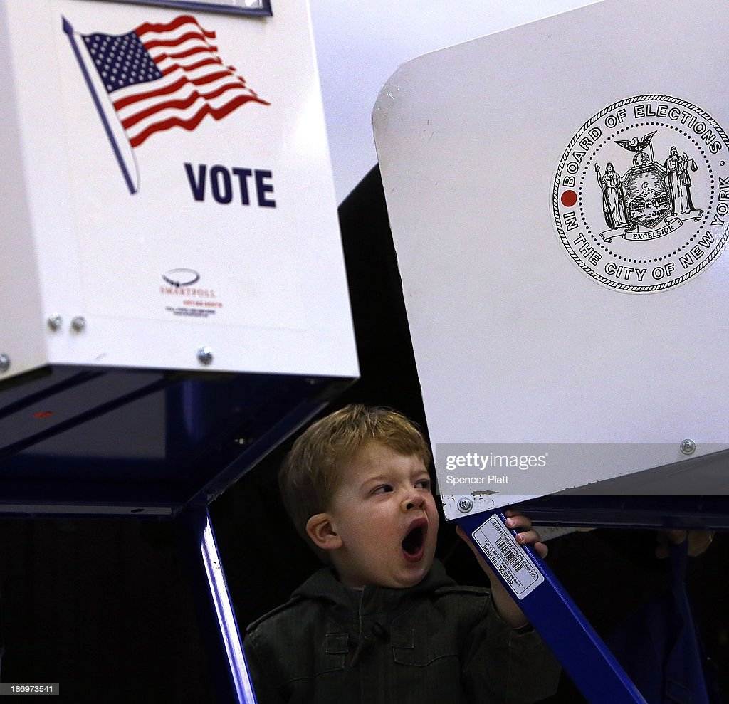 Tobias Nichols, 2, yawns while waiting for his father, Dan Nichols, to vote on Election Day on November 5, 2013 in the Brooklyn borough of New York City. New York Democratic mayoral candidate Bill de Blasio is running against Republican mayoral candidate Joe Lhota in a highly anticipated mayoral campaign.