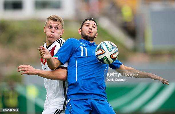 Tobias Pachonik of Germany challenges Luca Crecco of Italy during the international friendly match between U20 Germany and U20 Italy on September 3...