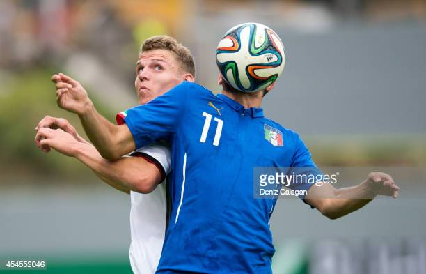 Tobias Pachonik of Germany challenges Luca Crecco of Italy for a header during the international friendly match between U20 Germany and U20 Italy on...