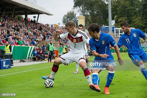 Tobias Pachonik of Germany is challenged by Filippo Costa of Italy and Luca Crecco of Italy during the international friendly match between U20...