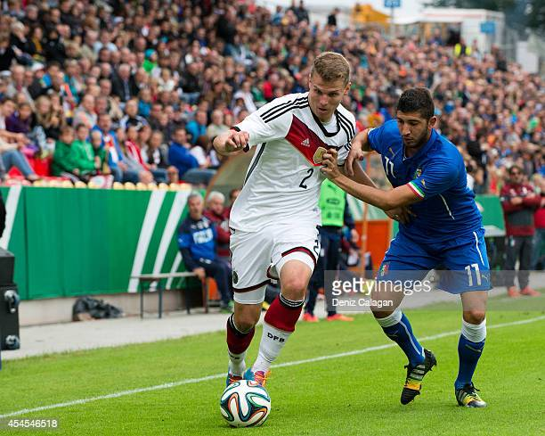 Tobias Pachonik of Germany is challenged by Luca Crecco of Italy during the international friendly match between U20 Germany and U20 Italy on...