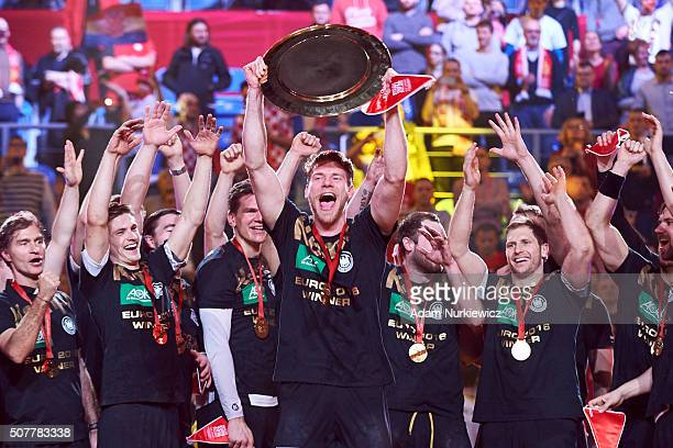 Tobias Reichmann from Germany with team mates celebrate gold medals while victory ceremony during the Men's EHF Handball European Championship 2016...