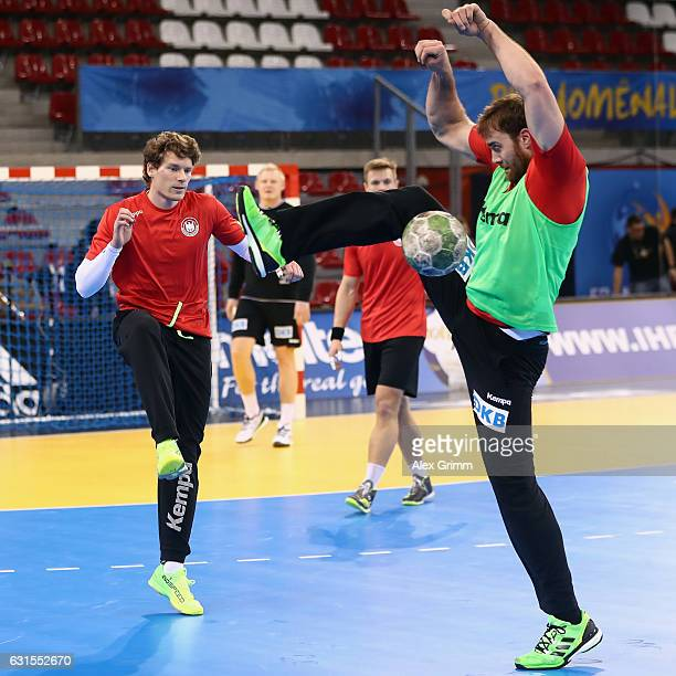 Tobias Reichmann is challenged by team mate Andreas Wolff during a Germany training session ahead of the 25th IHF Men's World Championship 2017 at...