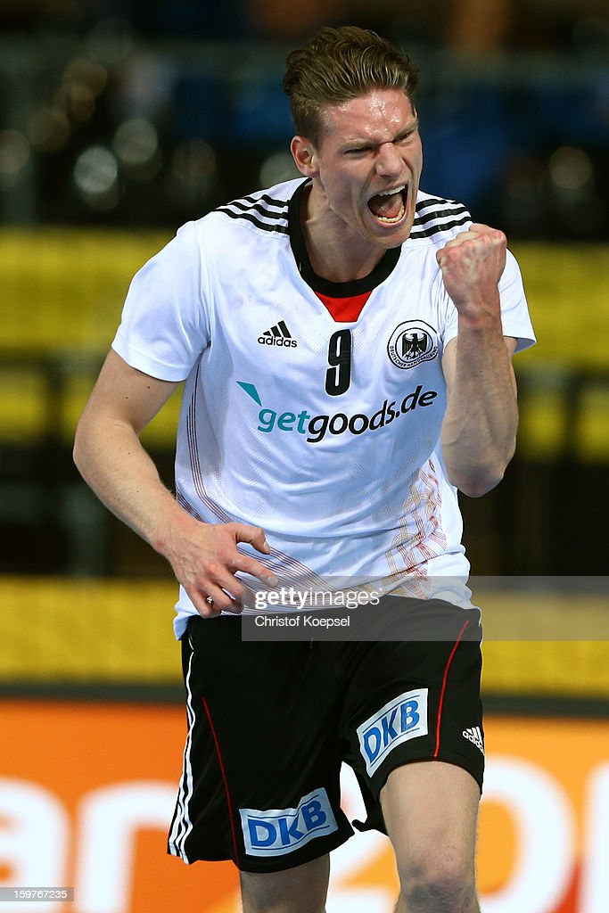Tobias Reichmann of Germany celebrates a goal during the round of sixteen match between Germany and Macedonia at Palau Sant Jordi on January 20, 2013 in Barcelona, Spain.