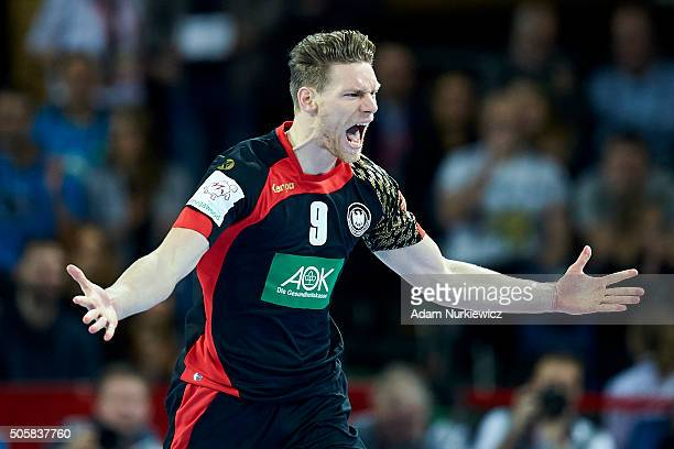 Tobias Reichmann of Germany celebrates after scoring during the Men's EHF Handball European Championship 2016 match between Germany and Slovenia at...