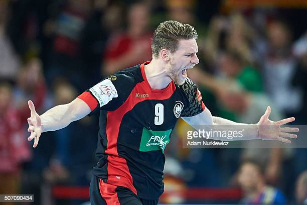 Tobias Reichmann of Germany celebrates after scoring during the Men's EHF Handball European Championship 2016 match between Germany and Denmark at...