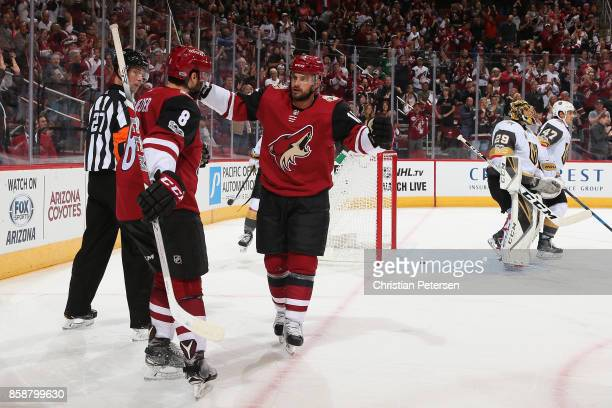 Tobias Rieder and Brad Richardson of the Arizona Coyotes celebrate after Rieder scored a goal against the Vegas Golden Knights during the first...