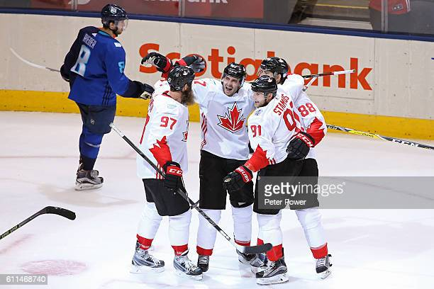 Tobias Rieder of Team Europe reacts as Patrice Bergeron of Team Canada is congratulated by his teammates after scoring a third period goal during...