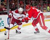 Tobias Rieder of the Arizona Coyotes and Jakub Kindl of the Detroit Red Wings battle for the puck in the corner during a NHL game on March 24 2015 at...