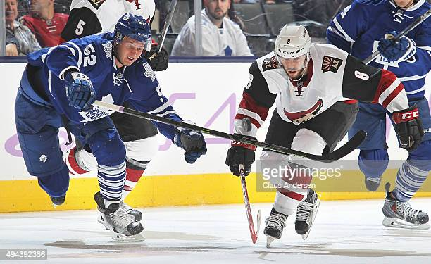 Tobias Rieder of the Arizona Coyotes battles against Martin Marincin of the Toronto Maple Leafs during an NHL game at the Air Canada Centre on...