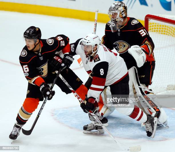Tobias Rieder of the Arizona Coyotes battles in front of the net against Brandon Montour and John Gibson of the Anaheim Ducks during the game on...