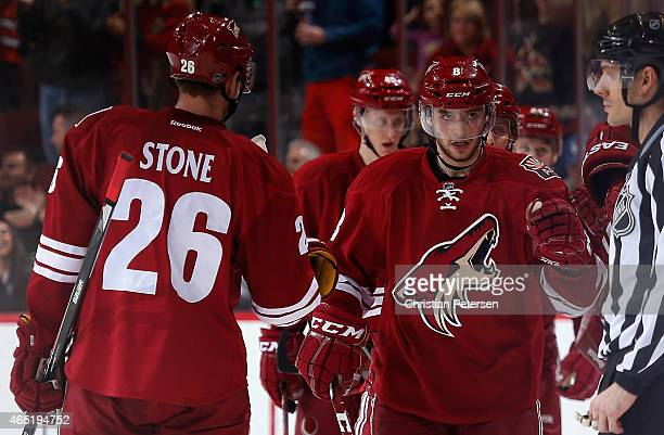 Tobias Rieder of the Arizona Coyotes highfives Michael Stone after Rieder scored a second period goal against the Anaheim Ducks during the NHL game...