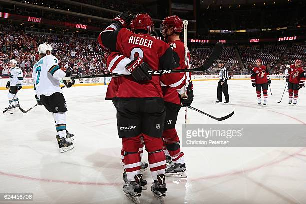 Tobias Rieder of the Arizona Coyotes is congratulated by Shane Doan after scoring a goal against the San Jose Sharks during the first period of the...
