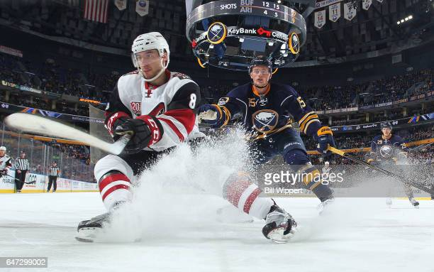 Tobias Rieder of the Arizona Coyotes makes a quick stop in front of Jack Eichel of the Buffalo Sabres during an NHL game at the KeyBank Center on...