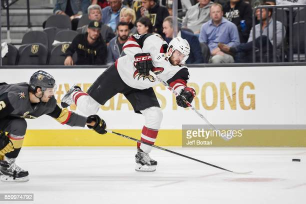 Tobias Rieder of the Arizona Coyotes shoots the puck with Colin Miller of the Vegas Golden Knights defending during the Golden Knights' inaugural...