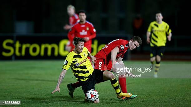 Tobias Ruehle of Sonnenhof Grossaspach challenges Erik Durm of Dortmund II during the Third League match between Borussia Dortmund II and SG...