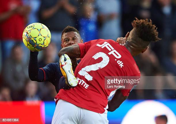 Tobias Sana of AGF Aarhus and Sammy Skytte of Silkeborg IF compete for the ball during the Danish Alka Superliga match between Silkeborg IF and AGF...