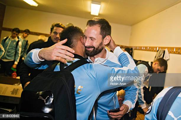 Tobias Sana of Malmo FF hugs Johan Wiland goalkeeper of Malmo FF and celebrating first place in the Swedish leauge in the looker room after the...