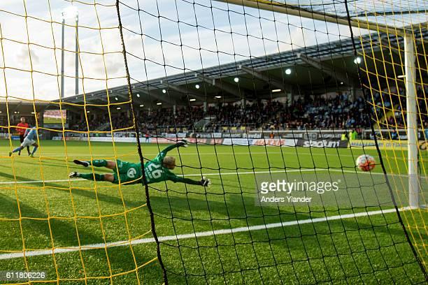 Tobias Sana of Malmo FF scores 24 behind Peter Abrahamsson goalkeeper of BK Hacken during the Allsvenskan match between BK Hacken and Malmo FF at...