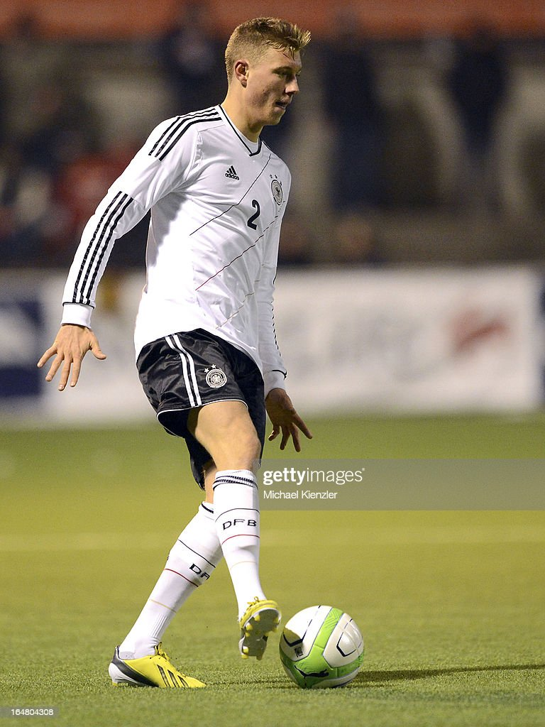 Tobias Schilk of Germany runs with the ball during the international friendly match between U20 Switzerland and U20 Germany at Eps Stadium on March 26, 2013 in Baden, Switzerland