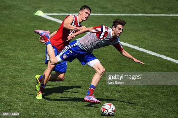 Tobias Schweinsteiger challenges Lucas Scholl during a Bayern Muenchen training session at day five of the Audi Summer Tour USA 2014 at Portland...