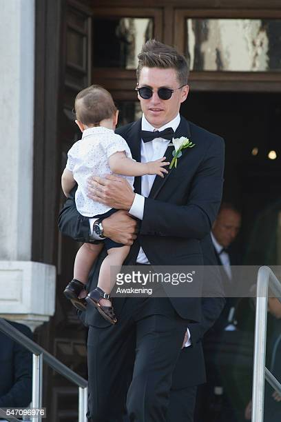 Tobias Schweinsteiger leaves the Aman Grand Canal Hotel to reach the church of the wedding of Bastian Schweinsteiger and Ana Ivanovic on July 13 2016...