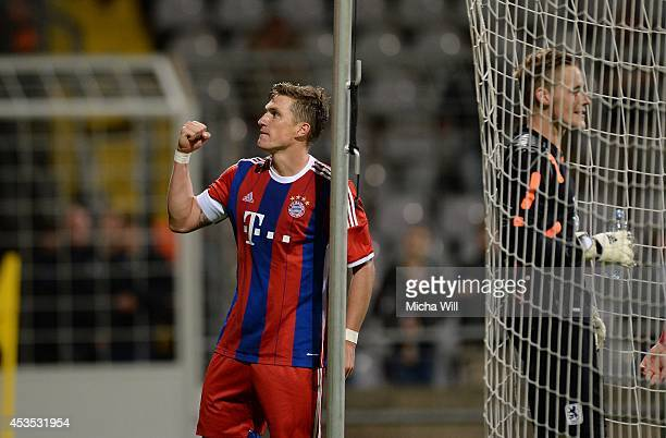 Tobias Schweinsteiger of Bayern Muenchen celebrates after scoring his team's third goal during the Regionalliga match between TSV 1860 Muenchen II...