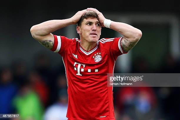 Tobias Schweinsteiger of Muenchen reacts during the Regionalliga Bayern match between FV Illertissen and Bayern Muenchen II on May 3 2014 in...