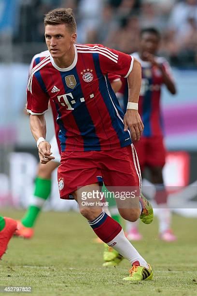 Tobias Schweinsteiger of Munich during the Telekom Cup 2014 Finale match between FC Bayern Muenchen and VfL Wolfsburg at Imtech Arena on July 27 2014...