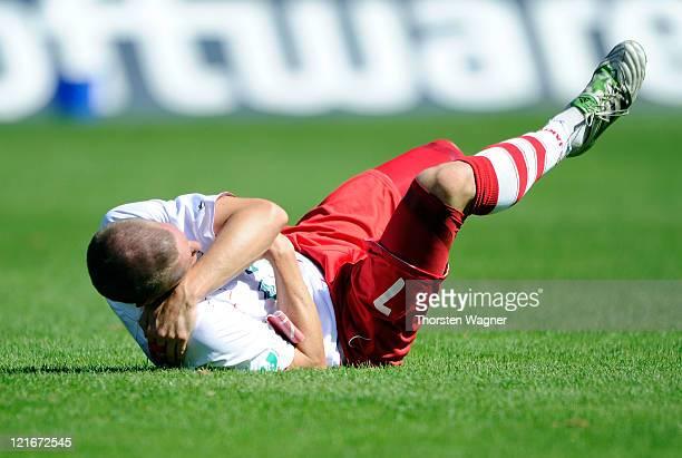 Tobias Schweinsteiger of Regensburg is lying on the pitch during the Theard League match between SV Darmstadt 98 and SSV Jahn Regensburg at stadium...