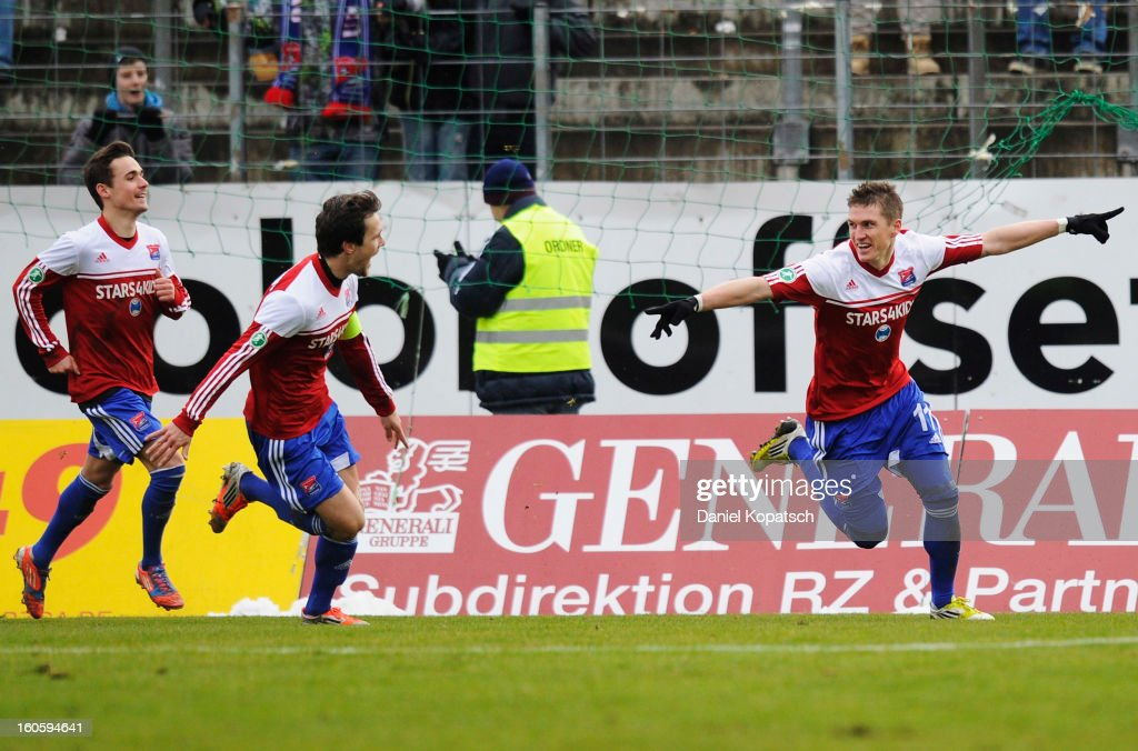 Tobias Schweinsteiger of Unterhaching (R) celebrates his team's first goal with team mates Stephan Thee (C) and Dominik Rohracker during the third Bundesliga match between SpVgg Unterhaching and Hallescher FC on February 3, 2013 in Unterhaching, Germany.
