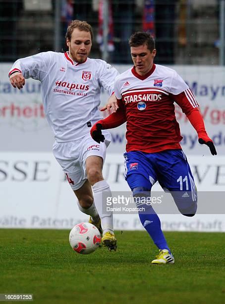 Tobias Schweinsteiger of Unterhaching is challenged by Timo Furuholm of Halle during the third Bundesliga match between SpVgg Unterhaching and...